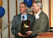 Photo of Dr. Levy receiving the Paul B. Magnuson Award from Dr. Nadeau